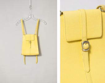 S A L E --- UNITED COLOURS of BENETTON 1990s pastel yellow backpack --- S A L E