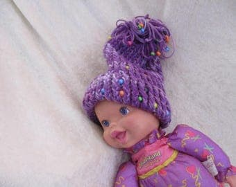 infant knitted purple hat with  beads and tassel