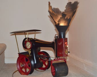 steampunk steam roller light singer bodied three way light.