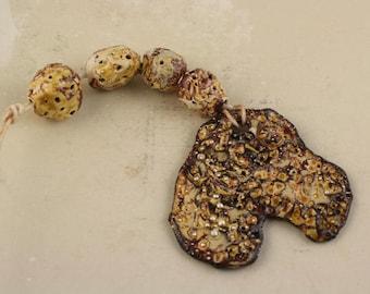 "Set of 4 handmade metallic ceramic glazed art beads focal and  including pendant  set""relic"""