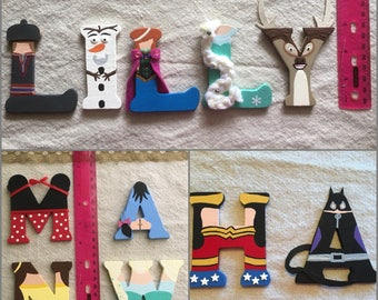 Disney Wooden Letters. Each letter is 3inches tall. Choose from Frozen, Beauty & Beast, Minnie, Winnie the Pooh Characters and more! (Girls)