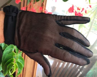 Pair of 1950s/60s era black short gloves.