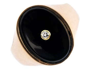 A Onyx and Diamond 14k Gold RIng,