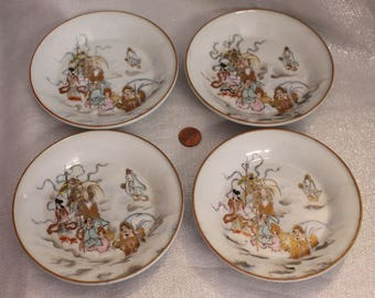 Four Beautiful Japanese Plates Decorated with People Clouds Gods and Scrolls Porcelain Japan