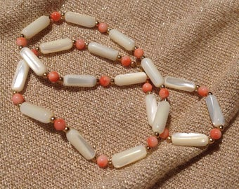 Row .1er choice of genuine coral, mother of Pearl and gold plated beads
