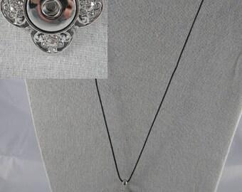 Black cotton thread and silver pendant necklace