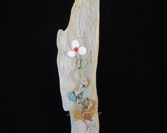 Driftwood Art Floral Design- flower with 3 white sea-tumbled pebbles, weathered wood, twisted stem & green pebble leaves enhance the piece!