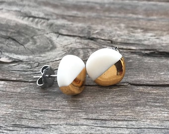 white and gold porcelain studs