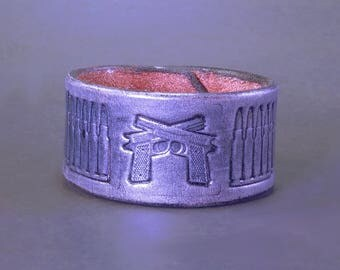 Guns and Bullets! Leather cuff stamped with crossed pistols and bullets - Metallic silver - Size 7.5