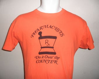 Vintage Original 1970s PHARMACISTS Do It Over The Counter Soft ORANGE T Shirt L