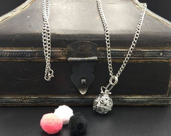 Diffuser necklace. Silver Sphere essential oil locket with chain and 3 refill poms.