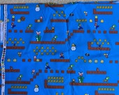 Mario Brothers quilt fabric - blue background with Mario, Luigi, Yoshi, and Lakitu - fabric by the yard