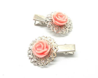 2 hair clips have silver plated rose flower hair