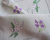 Vintage linen tea tray cloth. 1950s English green linen tray cloth with hand embroidered violets and lily of the valley. Great for tea party