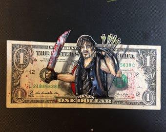 Daryl Dixon painted on a dollar bill