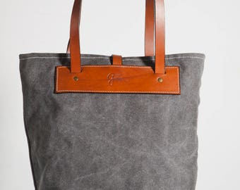 Grey canvas and brown leather tote