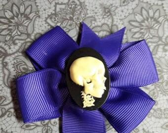 Dark purple loop with skull cabochon