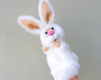 White rabbit.Bibabo. Puppet. Toy on hand. Toy glove. Puppet theatre. Marionette.