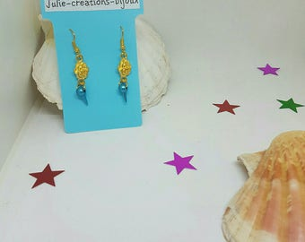 Flower and Pearl Metallic blue spike earrings