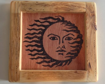 Handmade wood burning/ pyrography. Wood burned sun and reclaimed palletwood frame wall hanging artwork.