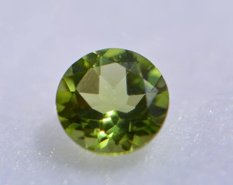 AAA Round Genuine Faceted Peridot ( 2mm- 7mm ). 811-011