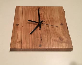 Cherry wall clock with a live edge