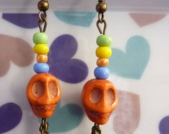 Earrings in antique bronze skull orange howlite seed beads multicolored and bronze chains