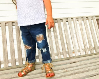 Girls all patched up jeans - distressed jeans with rips, holes, and sequins