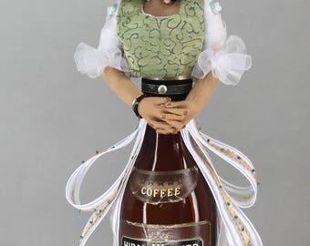 bottle doll. art doll, fiber art figure, vintage bottle