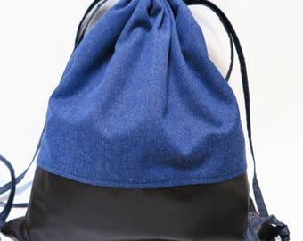Backpack / bag, blue fabric, brown leather