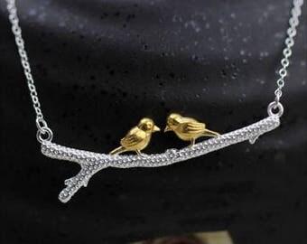 Golden birds on a branch