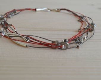 Multi strand necklace with thin details
