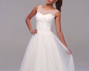 Wedding dress custom made of chiffon and lace sleeveless