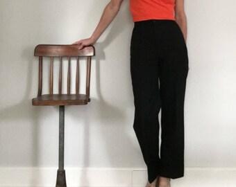 70s Big e Levis high waist bell bottoms// Black polyester pocket-less wide flare leg pants// Women's size 4-5 S small 26 W