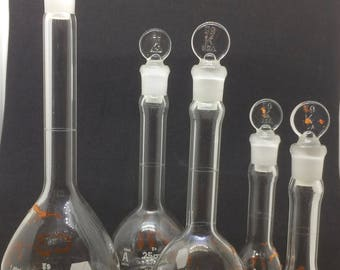5 vintage volumetric flasks, 50 ml, 25 ml, and 5 ml, Kimax, with glass stoppers