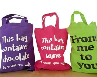Medium Cotton gift bags. Various slogans/colours.