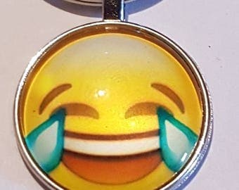 Emoji smiley face silver plated key chain.