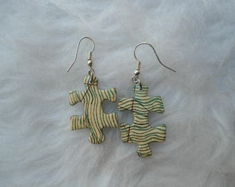 Puzzle map earrings.