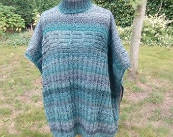 Handknitted poncho in blue-green-grey wool