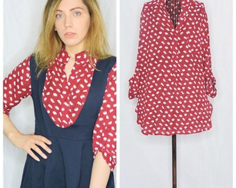Elephant patterned sheer red blouse
