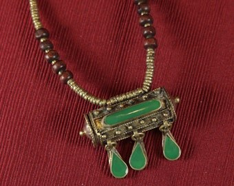 Vintage Kuchi necklace with openable green prayer box