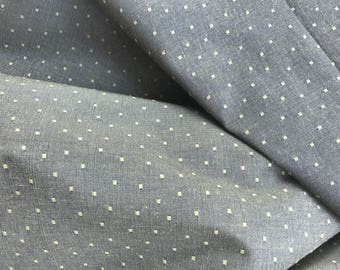 Olive dotted upholstery fabric