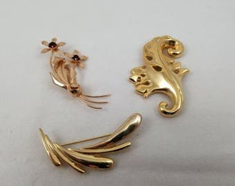 3 Gold Tone Brooches: Two Art Nouveau Waves and One Ruby Floral