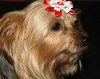 Dog bow, red white with snowflakes. button in the center.