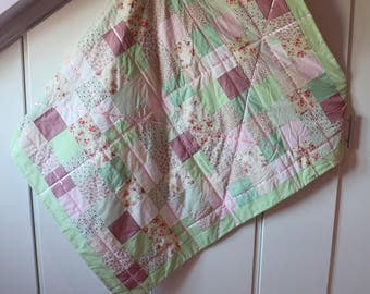 Pink and green baby quilt