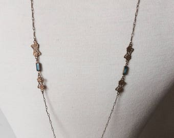 Necklace in brass and blue glass beads
