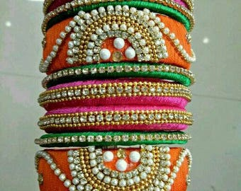 Custom designed hand made silk thread bangles and earrings