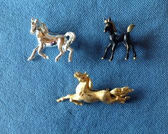 Three horse pins