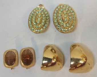 Vintage Gold Tone Clip On Earrings Lot: Sarah Coventry amber rectangles; oval with concentric rows of green stones; & chunky 80s hoops