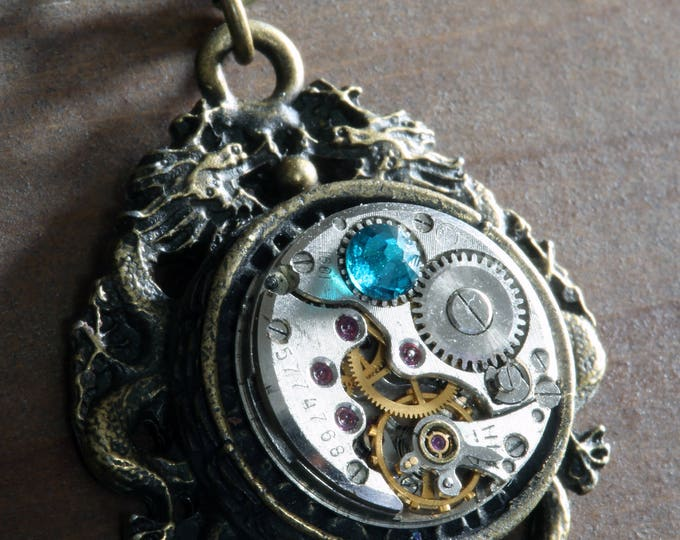 Steampunk Jewelry -  NECKLACE - Dragon and Antique Watch Movement with dark aqua crystal - Antique bronze